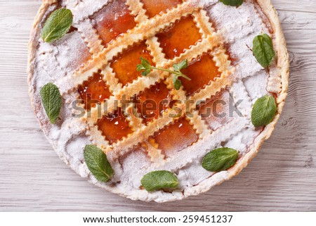 Italian tart with apricot jam close up on the table. horizontall top view - stock photo