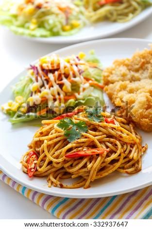 Italian Thai Fusion food, Thai red curry  spaghetti with fried fish. - stock photo