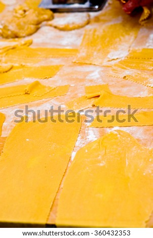 Italian traditional kitchen base ingredients needed to prepare pasta on a food staple. - stock photo