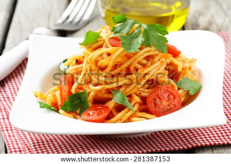 Italian traditional pasta - spaghetti with tomato sauce - stock photo