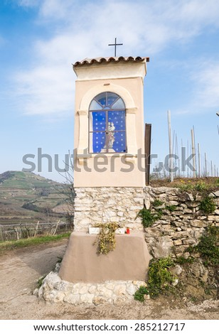 Italian traditional votive temple in the countryside dedicated to saint joseph to propitiate the harvest - stock photo