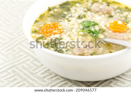 Italian wedding soup with meatballs and pepe noodles - stock photo