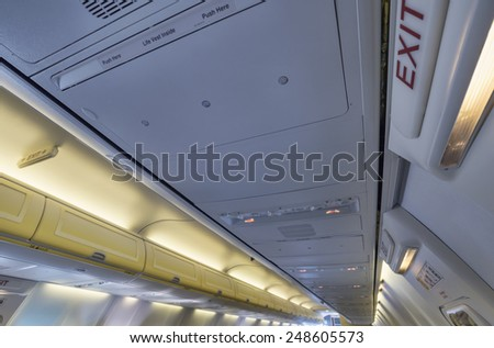 Italy, airplane cabin, emergency exit lights - stock photo