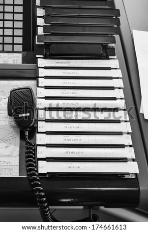 ITALY, Bari, International airport, flight control tower, flight control strings and flight controller microphone - stock photo