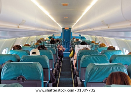 Italy, Bologna airport, Inside a passenger plane - stock photo
