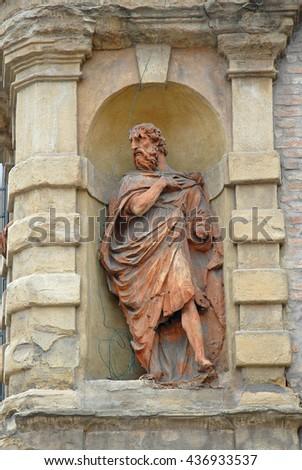 Italy, Bologna old medieval statue at Castelfidardo street, Tagliapietre street. - stock photo