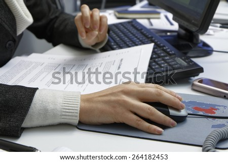 Italy, business woman working in her office - stock photo