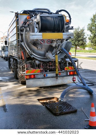 ITALY, CAORLE,15, APRIL, 2016, cleaning truck pumps out the water drain, ITALY, CAORLE,15, APRIL, 2016 - stock photo
