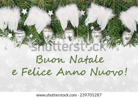 italy Christmas card with Pine green, baubles, angel wings and text Merry Christmas and a happy New Year/Merry Christmas and a happy New Year/italy - stock photo