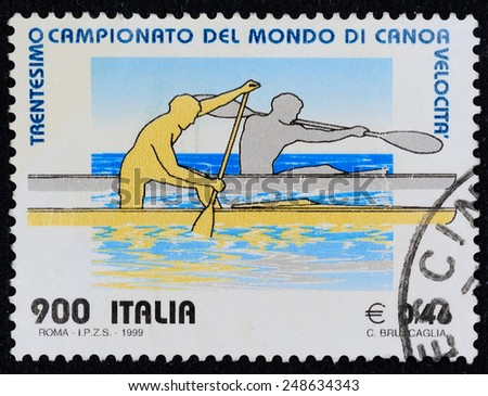 ITALY - CIRCA 1999 A stamp printed in Italy dedicated to thirtieth world championship canoeing in speed, C. Bruccaglia, circa 1999 - stock photo