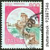 "ITALY - CIRCA 1980: A stamp printed in Italy from the ""Castles"" issue shows Rocca Maggiore, Assisi, circa 1980. - stock photo"