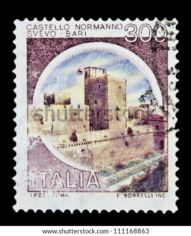 """ITALY - CIRCA 1980: A stamp printed in Italy, shows castle Normanno Svevo, Bari with the same inscription, from the series """"Italian castles"""", circa 1980 - stock photo"""