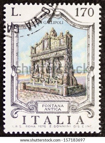 ITALY - CIRCA 1976: a stamp printed in Italy shows Fontana Antica (Old Fountain), the oldest fountain in Italy, built in the third century b.C. in Gallipoli. Apulia region. Italy, circa 1976 - stock photo