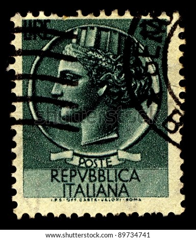 ITALY-CIRCA 1955:A stamp printed in Italy shows image of Italia Turrita is the national personification of Italy, characterised by a mural crown typical of Italian civic heraldry, circa 1955. - stock photo