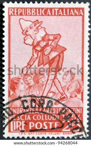 ITALY - CIRCA 1954: A stamp printed in Italy shows Pinocchio, circa 1954 - stock photo