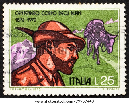 ITALY - CIRCA 1972: a stamp printed in the Italy shows Alpine Soldier and Pack Mule, Centenary of the Alpine Corps, circa 1972 - stock photo