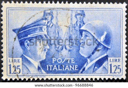ITALY - CIRCA 1941: mail stamp printed in Italy showing Hitler and Mussolini face to face, circa 1941 - stock photo