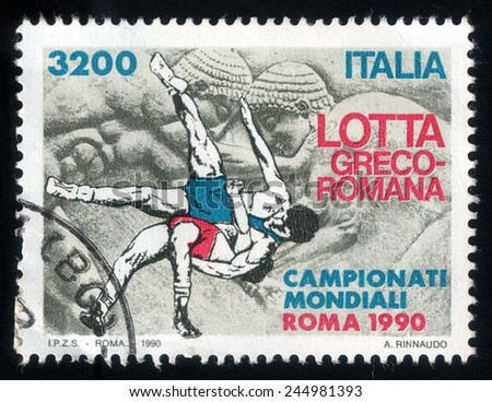 ITALY - CIRCA 1990: postage stamp printed in Italy shows picture of Greco-Roman wrestling during international championship - stock photo