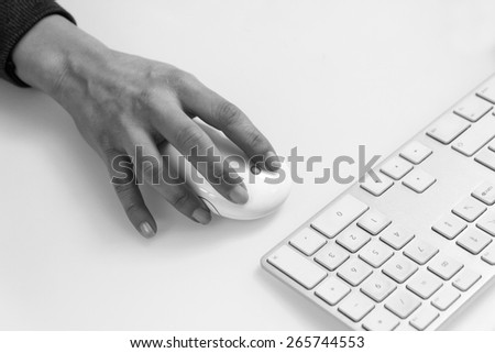 Italy, female hand on a computer mouse and keyboard - stock photo