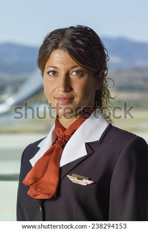 Italy, flight stewardess portrait - stock photo