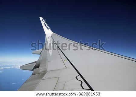 Italy; 26 January 2016, flying airplane wing  - stock photo