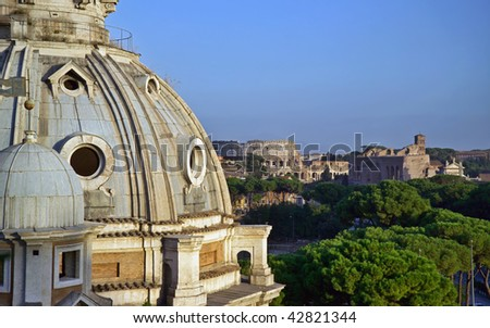 Italy, Lazio, Rome, view of the Imperial Forum and Coliseum at sunset - stock photo
