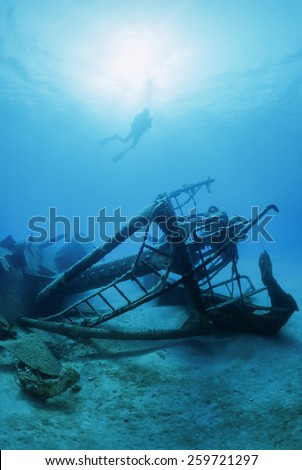 Italy, Mediterranean Sea, diver and a sunken ship wreck - FILM SCAN - stock photo