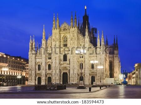 Italy Milan Duomo cathedral piazza duomo brightly illuminated historic landmark at sunrise  - stock photo