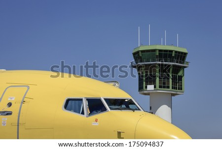 Italy, Naples International Airport, airplane and Control Tower - stock photo