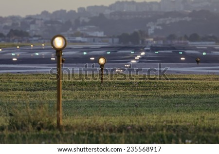 Italy, Napoli International Airport, flight security lights and landing strip in the bakground - stock photo