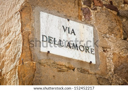 Italy - Pienza town. The streetsign of Via dell'amore (Love Street) - stock photo