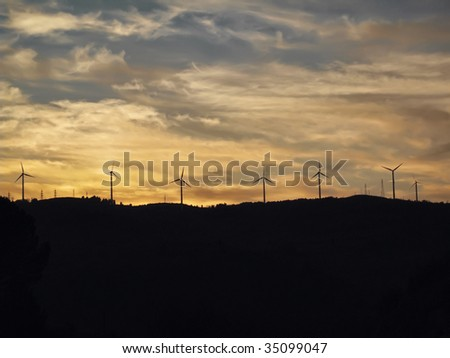 ITALY, Salerno, countryside, Eolic energy turbines at sunset - stock photo