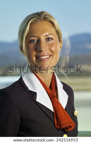 Italy, Sardinia, Olbia International Airport, flight stewardess portrait - stock photo