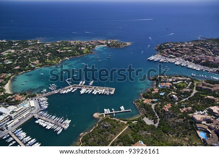 Italy, Sardinia, Olbia province, aerial view of the Emerald Coast, the Tyrrhenian Sea and Porto Cervo marina - stock photo