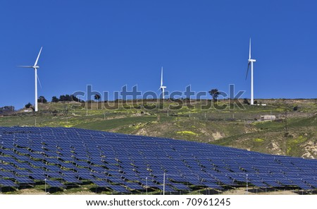 ITALY, Sicily, Agrigento province, countryside, Eolic energy turbines and solar energy panels - stock photo