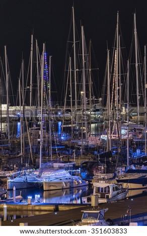 Italy, Sicily, Mediterranean sea, Marina di Ragusa; 15 December 2015, luxury yachts with Christmas lights in the marina at night - EDITORIAL - stock photo