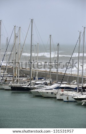 Italy, Sicily, Mediterranean sea, Marina di Ragusa, view of luxury yachts in the marina in a stormy day - stock photo