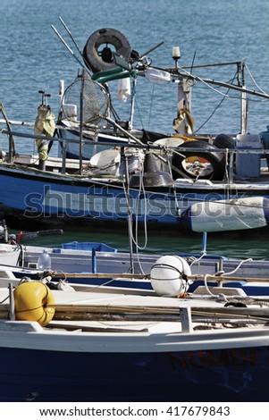 Italy, Sicily, Mediterranean sea, Marina di Ragusa; wooden fishing boats in the port - stock photo