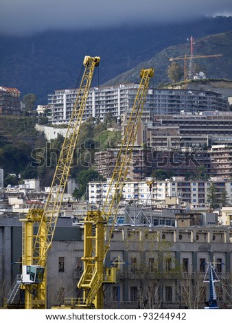 Italy, Sicily, Messina, view of the city and the port structures - stock photo