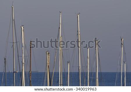 Italy, Sicily; 16 November 2016, sailing boats masts in a marina at sunset - EDITORIAL - stock photo