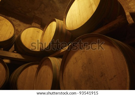 Italy, Sicily, Ragusa province, wooden wine barrells in a wine cellar - stock photo