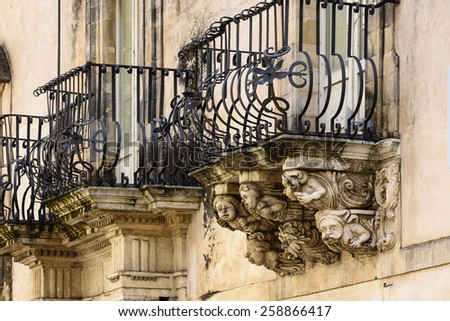 Italy, Sicily, Ragusa, Zacco Palace baroque facade and balconies (Unesco Monument), XVIII century. - stock photo