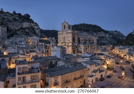 Italy, Sicily, Scicli (Ragusa Province), view of the town and S. Maria La Nova Neoclassic Church (1816 a.C.) at sunset - stock photo