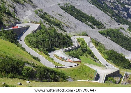 Italy, Stelvio National Park. Famous road to Stelvio Pass in Ortler Alps. Alpine landscape. - stock photo