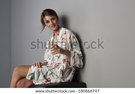 Italy, studio portrait of a beautiful girl with a glass of white wine - stock photo
