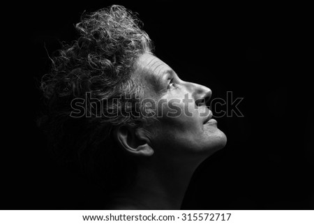 Italy, studio portrait of a middle age woman - stock photo