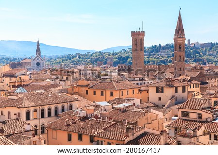 Italy, Tuscany, Florence. View from the bell tower of the Cathedral of Santa Maria del Fiore. Towers of National Museum of the Bargello and Badia Florentina. In left side the Basilica of Santa Croce - stock photo