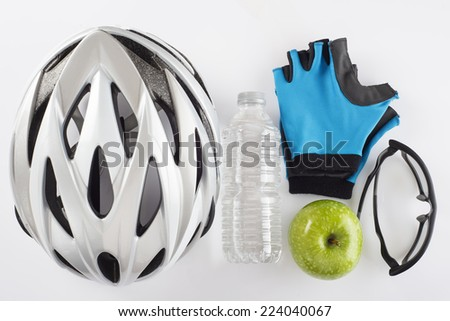 Items for a safe cycling and a healthy diet isolated on a white background - stock photo