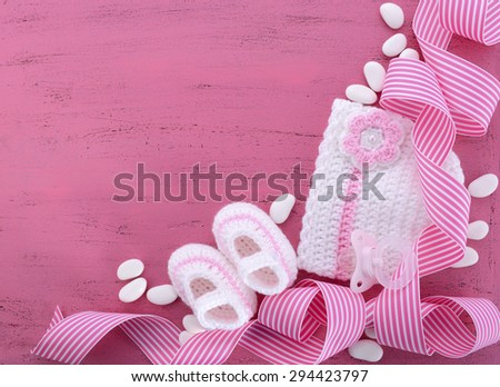 Its a Girl Baby Shower or Nursery background with baby clothes and accessories with copy space for your text here. - stock photo