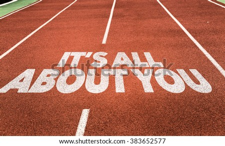 Its All About You written on running track - stock photo